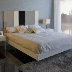 Dormitorio moderno con cabezal de diseño
