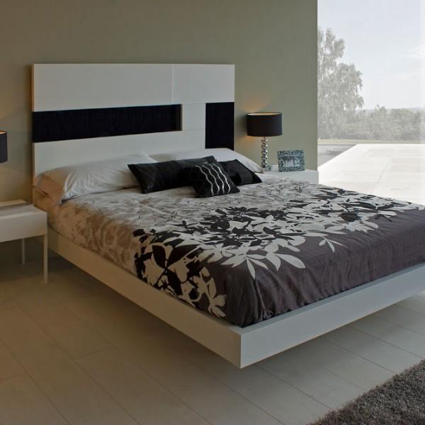 Dormitorio moderno con mesitasy cabezal blanco y negro