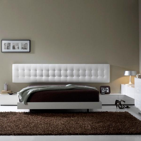 Dormitorio de diseño con rinconera en la parte derecha